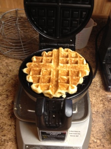 The waffle turned out golden brown in no time at all.  It stuck a little to the top of the waffle iron, but came away easily with a fork.