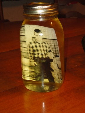 Photo in mason jar filled withoil